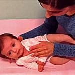 cómo tumbar y levantar al bebé, blog fisioinfancia